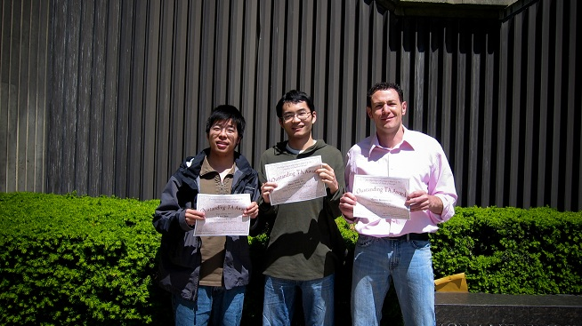 3 students holding awards