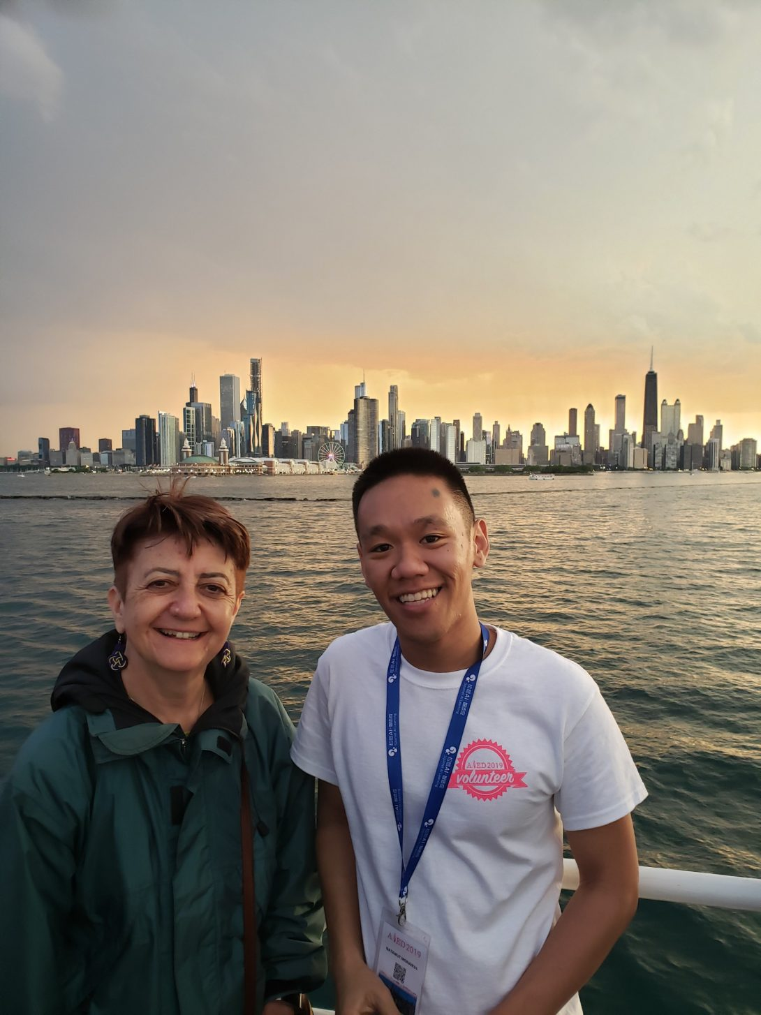 Professor Barbara Di Eugenio and Natawut Monaikul on a boat with the Chicago skyline in the background